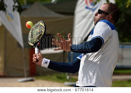MOSCOW, RUSSIA - JULY 17, 2015: Ramon Guedez of Venezuela in the quarterfinal match of ITF Beach Tennis World Team Championship against Spain. Spain won the match 2-1
