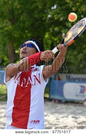 MOSCOW, RUSSIA - JULY 17, 2015: Kotaro Aizawa of Japan in the quarterfinal match of the Beach Tennis World Team Championship against Russia. Russia won the match 3-0