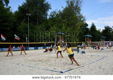 MOSCOW, RUSSIA - JULY 18, 2015: Semifinal match Russia (red shirts) vs Brazil (yellow shirts) of the Beach Tennis World Team Championship. Russia won the match 2-1