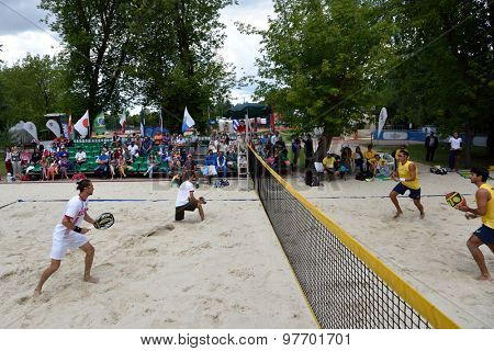 MOSCOW, RUSSIA - JULY 18, 2015: Semifinal match Russia (left) vs Brazil (yellow shirts) of the Beach Tennis World Team Championship. Russia won the match 2-1