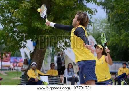 MOSCOW, RUSSIA - JULY 18, 2015: Vinicius Font (center) and Joana Cortez of Brazil in the semifinal match of the Beach Tennis World Team Championship against Russia. Russia won the match 2-1