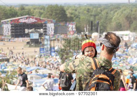 Man Holding Little Child.