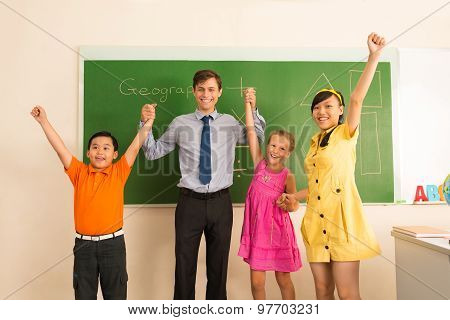 Happy Teacher And His Pupils