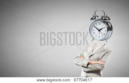 Businesswoman with alarm clock instead of her head