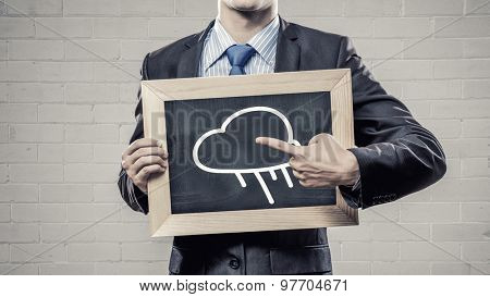 Close up of businessman holding frame with cloud computing concept