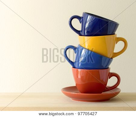 Stack Of Colorful Coffee Cups On Table