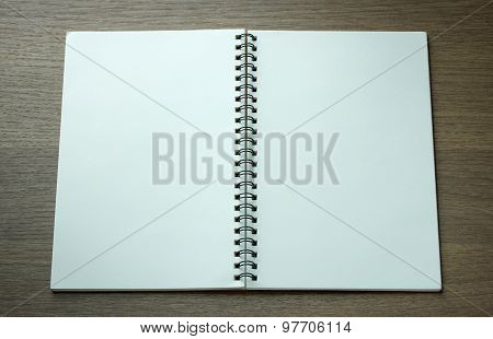 Open Spiral Notebook On Dark Wood Background