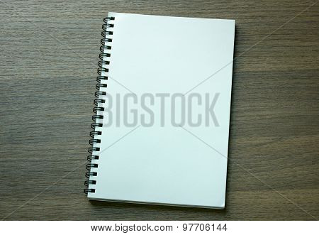 Blank Spiral Notebook On Dark Wood Background