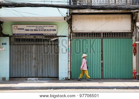 Vietnamese woman on the street of Saigon