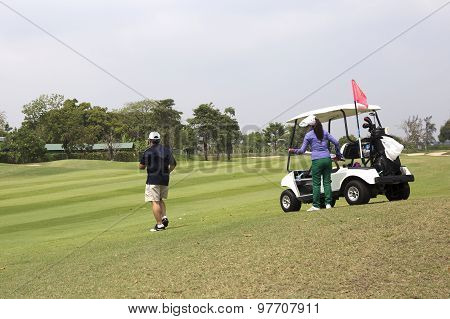 Golfer Looking Fairway Positioned In Golf Stance