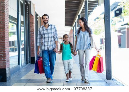 Happy family with shopping bags at the mall