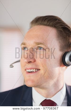 Happy call center agent working in his office