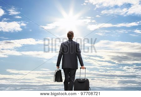 Business Man Travel With Trolley Walking To The Sky