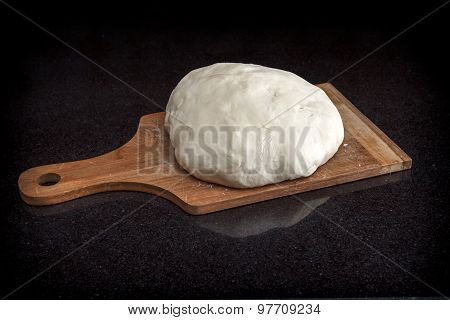 Closeup Of Pastry Dough On Baking Board