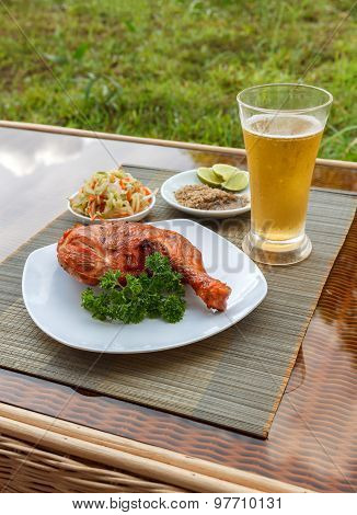 Grilled Chicken On White Plate With Parsley, Salad And Beer Outdoors