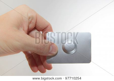 Female Hand Hold One Medical Pill In Blister Pack