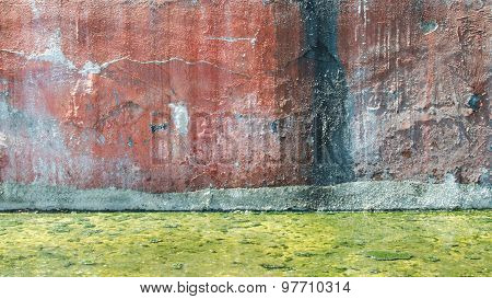 Grunge Concrete Wall And Green Polluted Water At Ground