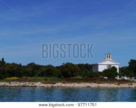 A white church on the graveyard of Olib