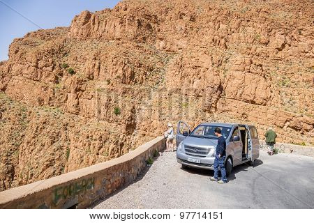 BOUMALNE, MOROCCO, APRIL 11, 2015: Tourists stoped their car and look the landscape of Dades Gorges from a view point
