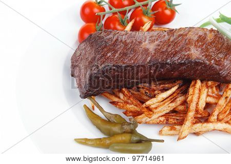 meat food : grill beef on potato chips with fresh tomato and hot green peppers isolated on white background