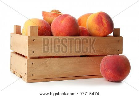 Fresh peaches in wooden crate isolated on white