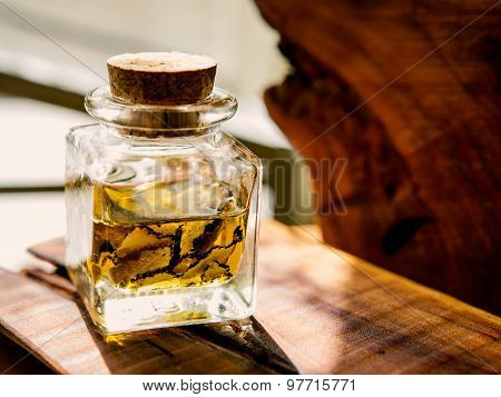 Mushrooms Black Truffle In The Bottle With Oil