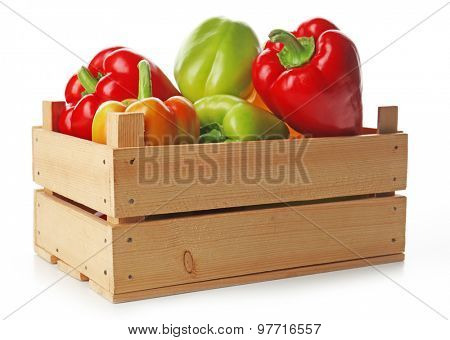 Colorful peppers in wooden crate isolated on white