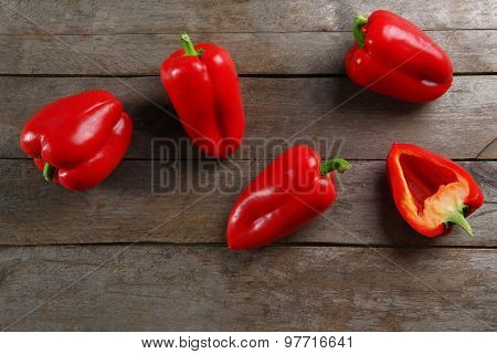 Red peppers on rustic wooden background