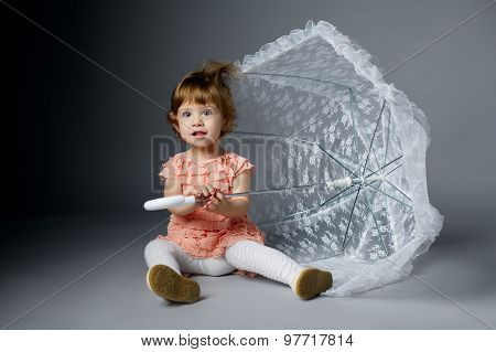cute little girl with lace umbrella