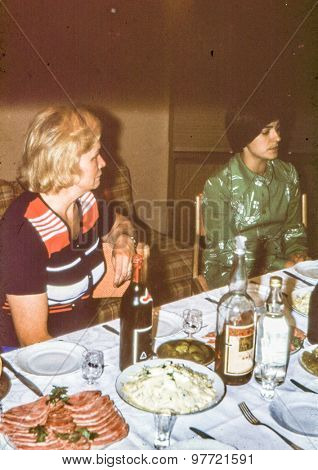 Vintage photo (scanned reversal film) of two woman during family dinner, early 1970's