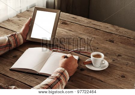 Hand Of Man Writing Something In A Blank Notebook