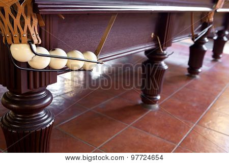 Billiard table with spheres in a billiard pocket