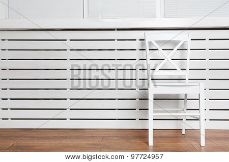 Chair on white wooden planks background