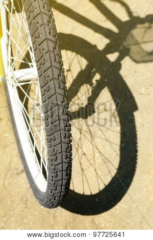 Bicycle over sand background