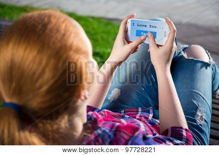 Teenage Girl Sending Sms Message With Text