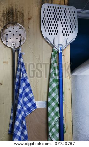 Oven shovels on wooden wall background