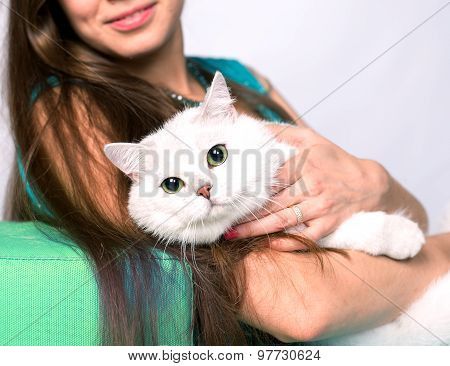 Portrait of a smiling girl sitting and hugging cat. Selective Focus.