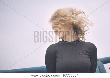 Beautiful woman with a happy expression on her face looking to the right