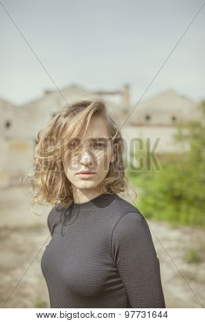 Beautiful woman with a serious expression on her face looking straight ahead