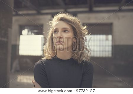Beautiful woman with a serious expression on her face looking right