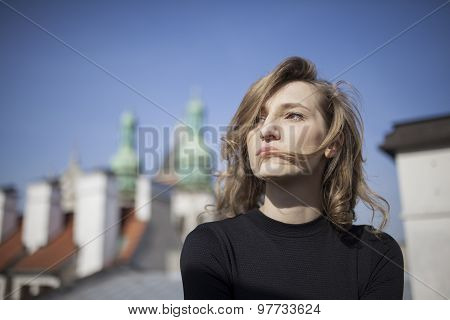 Beautiful woman with a serious expression on her face looking up