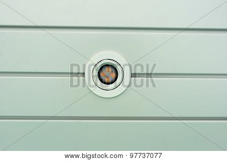 White And Orange Decorate Ceiling Lamp On Groove Ceiling