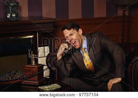 Businessman Makes An Important Phone Call.