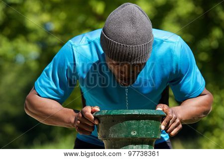 Thirsty African American Man Drinking Water