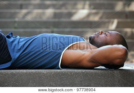 Man Lying On Back Resting Outside