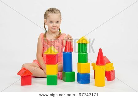Child Cheerfully Plays With Blocks