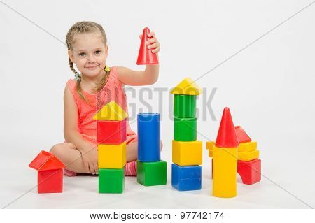 Four-year Child Is Having Fun Playing With Blocks