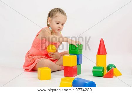 Girl Playing In Developing A Set Of Dice