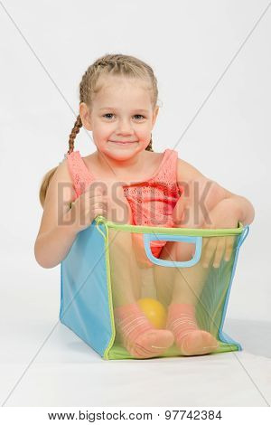 Cheerful Girl In A Box For Toys