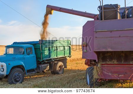 Harvester pours grain into a truck
